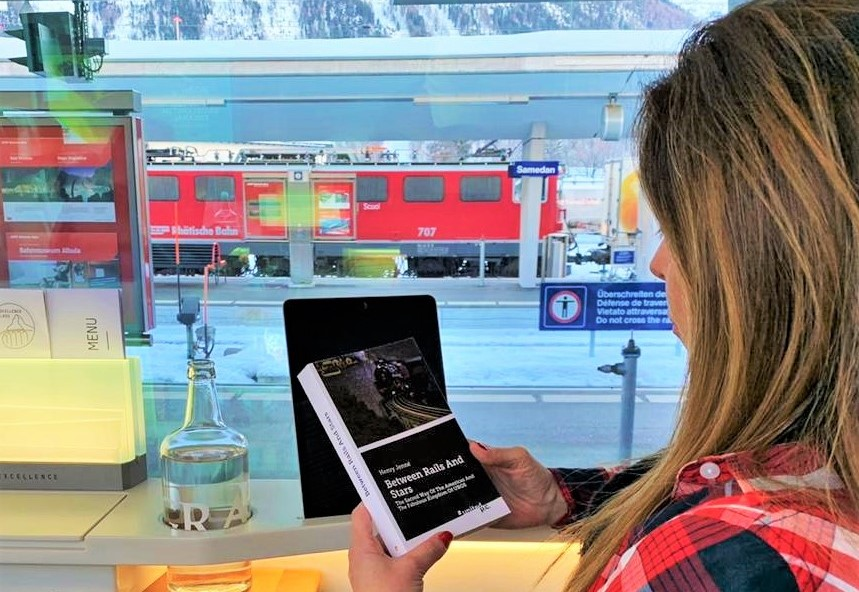 """Wonderful picture of the book """"Between Rails and Stars"""" in Switzerland, on board of the Glacier Express Train."""