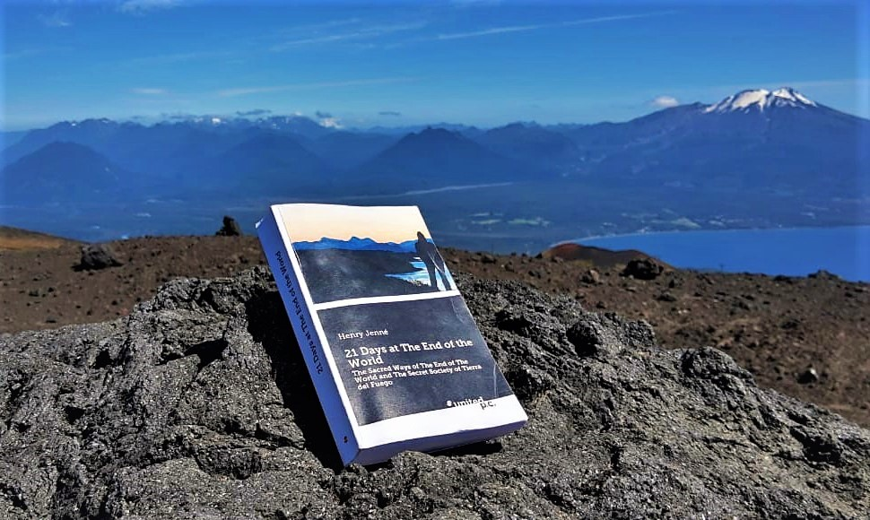 """A wonderful picture of the book """"21 Days at The End of The World"""" on the mountanis around the region of Puerto Varas – Chile, with the Osono Volcano and the Lake Llanquihue in the backgroung. Picture taken by Mauro Molina during his travel to the extreme South of America."""